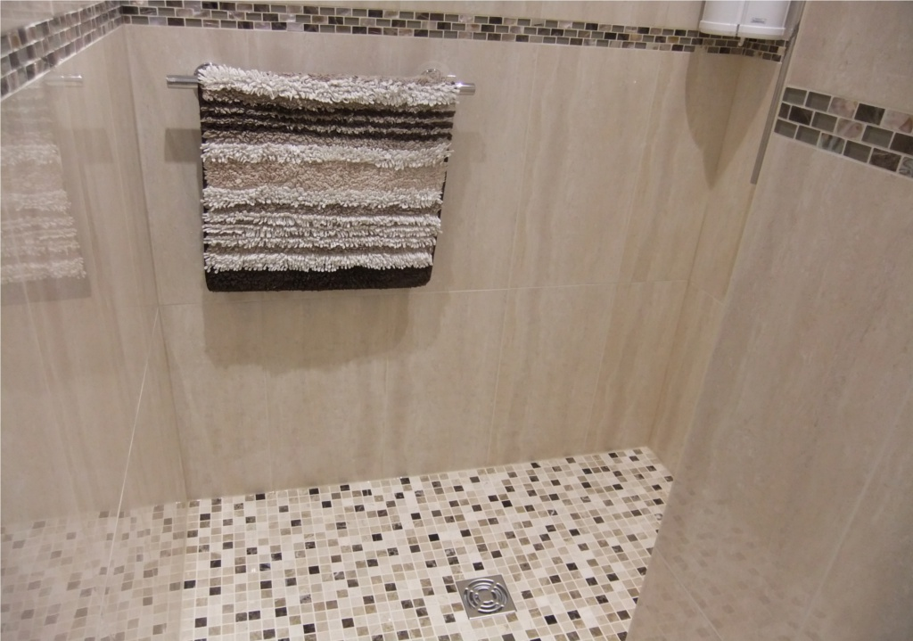 Luxury wet room at curtis brothers with mosaics for Wet room mosaic floor tiles